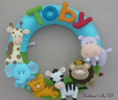 Jungle Name wreath, nursery decor, personalized felt name, baby gift, child room wreath, name wreath, custom felt name, MADE TO ORDER by DoodlepipCrafts on Etsy https://www.etsy.com/listing/220771659/jungle-name-wreath-nursery-decor