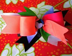 This is a good tutorial for hairbows! I love the idea to use spray stiffiner to make the bows keep their shape
