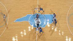 UNC and Duke tip off in the Dean E. Smith Center. (© Jeffrey A. Camarati)