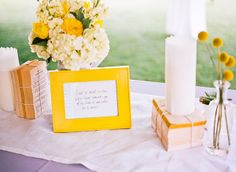 Spray paint yellow and blue frames for each table