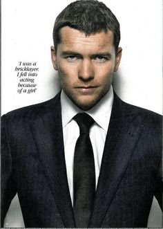 sam worthington!  If it's really true he was a bricklayer- oh man.......