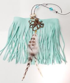 Faux suede armlet, with fringes. This upper arm bracelet has a lovely light green color.  https://www.etsy.com/nl/shop/SpectralStories