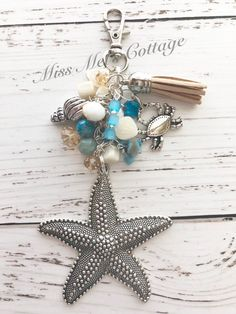 Silver Starfish Zipper Bag Charm/Keychain with mini beads, tassel and ocean charms/bag/purse/keychain/planner/car rearview mirror/fan charm by MissMelsCottage on Etsy Sea Jewelry, Beaded Jewelry, Jewellery, Unique Jewelry, Tassel Purse, Tassel Keychain, Bling Purses, Sunflower Necklace, Chunky Beads