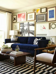 This is a great space. Seriously! Love the art. Love the couch. Love the rug. via Habitually Chic®