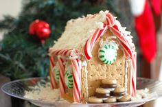 "Make ""gingerbread houses"" from graham crackers - you probably have all the ingredients in your cupboard right now!  (step-by-step instructions)"
