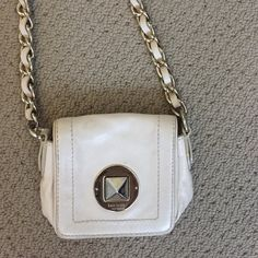 Kate Spade cross body purse Cream leather with light gold detail cross body bag. Gently used, some scuffs and small scratches on the gold detail. Some marks on the inside of the purse. Great for going out, comes with dust bag. WILL SHIP JUNE 21st kate spade Bags Crossbody Bags