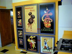 art prints decoupaged on cabinet doors.
