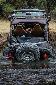 Fording a river in a Jeep Wrangler