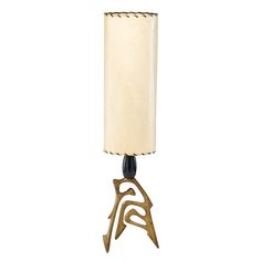 """1087: FREDERICK WEINBERG Estimate: $400 - $600   Columnar table lamp on sculptural tripod base, USA, ca. 1950s; Patinated metal, laced parchment, enameled wood; Signed; 27 1/2"""" x 6 1/4"""" dia."""