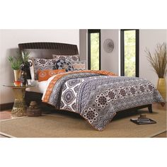 Add a unique style to your bedroom with this stunning oversized quilt set in rich purple tones and elegant medallion designs. This durable set is crafted of quality cotton and conveniently machine washable.
