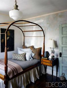 An antique canopy bed from Marjorie Merriweather Post's Adirondacks camp in another guest room.