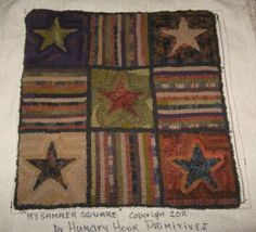 nice hit and miss rug from Hungry Hook Primitives....  I love the colors!