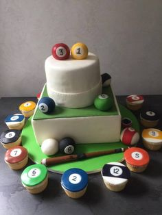 A pool/Billiards birthday cake theme, with the cupcakes to match. https://www.facebook.com/EnglishDreamCake/photos/a.875299899229637.1073741834.875241095902184/1125809740845317/?type=3&theater