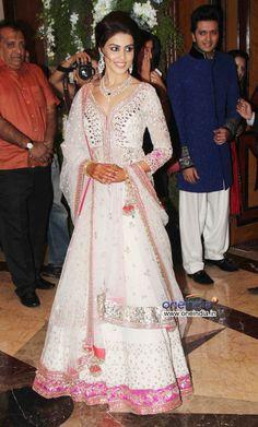 Actor Genelia D'Souza at her pre wedding sangeet ceremony {with fellow actor Ritesh Deshmukh (in blue Nehru Jacket)}