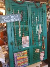 Display idea using shutters for anything that hangs: artwork, greeting cards & jewelry.