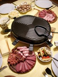 Raclette (a very common winter dish in France, where regions such as Savoie and Franche-Comté make a cheese very close to the Swiss raclette). Cover baked potatoes, ham and salami with the melted cheese.