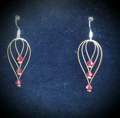 Boucles d'oreilles (diamants rouge)