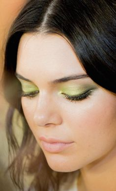 Lime green eyes backstage at Atelier Versace Couture