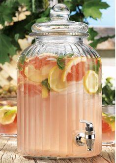 Grapefruit wedges, mint, and lemons in lemonade... lovely presentation!