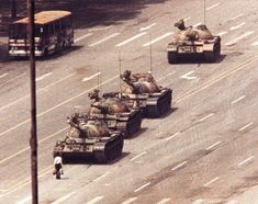 A man stands in front of a convoy of tanks in the Avenue of Eternal Peace in Tiananmen Square in Beijing, June 5, 1989. REUTERS/Arthur Tsang