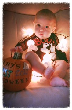 Baby's first Halloween. I like the pumpkin idea. My little man won't be able to sit up though...