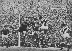 15th February 1964. Everton goalkeeper Gordon West comes out of his goal but fails to catch the ball allowing Sunderland centre half Charlie Hurley to score in a 3-1 win in the FA Cup 5th Round, at Roker Park.