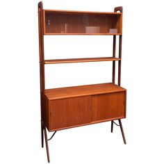 Kurt Ostervig Book Shelf/Cabinet | From a unique collection of antique and modern bookcases at https://www.1stdibs.com/furniture/storage-case-pieces/bookcases/