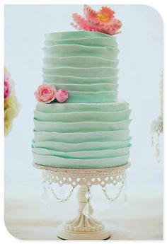 love this too, but 3 tier, no flower and maybe in the piny coral color since we have a lot of the tiffany blue elsewhere