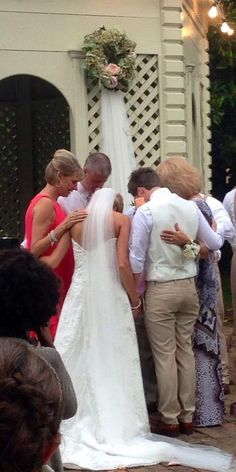 Caleb and Kelsey Grimm ~ 7/19/14 praying at their wedding...love that about Caleb and Kelsey