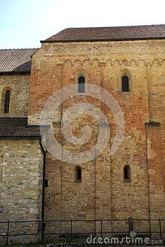 Photo about Cluniac Romainmôtier Abbey in Romainmôtier Switzerland is Swiss heritage site of national significance. Image of buttress, arched, famous - 70225351 Romanesque, Travel Europe, Heritage Site, Switzerland, Spain, Stock Photos, Image, Romanesque Art, Spanish