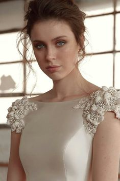 A bateau neckline gown featuring our signature floral embroidery at the shoulders. Couture bridal gowns for the orthodox bride, mormon bride and modest bride. Modest Wedding Dresses, Wedding Dress Styles, Bridal Dresses, Wedding Gowns, Blouse Designs, Beautiful Dresses, Designer Dresses, Evening Dresses, Fashion Dresses