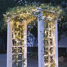 good idea to put lights on it....Garden arbor with lights