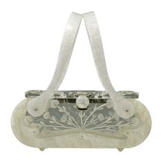 1950's Double Carved Vintage Lucite Handbag by Rialto.  Not only does it have a decorative hand cut floral design front & back panel, it also has a cut out front & back. The top design is molded. The handles & body of the bag are pearlized plastic