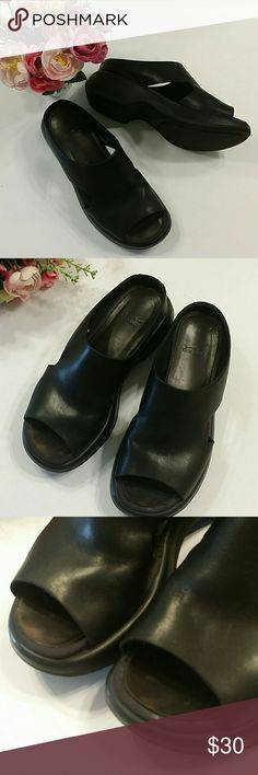 Dansko sandals, sz 38 Black sandals Made in Portugal, size 38 Most signs of wear are discoloration on the footbed, still in very good condition Dansko Shoes Sandals