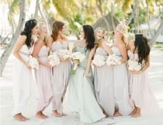 blue mermaid wedding dress and bridesmaids in pink