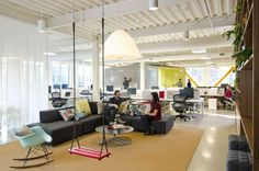 Casual work space designed by Boora Architects Cool Office Space for FINE Design Group by Boora Architects