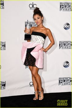 2015 ama's   About This Photo Set: Ariana Grande gets on stage to accept her award ...