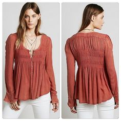Free People Loose Knit Free People rust distressed baby doll style tunic with button and smoking details . Free People Tops