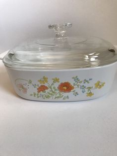 Casserole has handles. Lid is Pyrex A-9-C. Neither have any flaws, chips or smells. Wildflower Poppy pattern is pink, orange, yellow and has little blue flowers with green stems on a white background. | eBay!