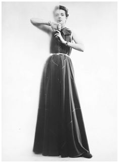 Claire McCardell in her Futuristic Dress (cut only of triangles), photographed by Erwin Blumenfeld, 1945