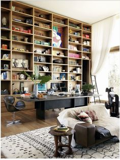 Living room with giant wooden bookshelf