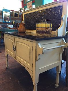 Sideboard with marble top beautifully distressed in American Paint Company Home Plate.