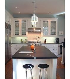 This honed granite is very pretty and timeless looking.  The description of it says it's less problematic to clean than buffed granite.