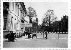 1941. Entrance to the Jewish Quarter in Amsterdam. The Jewish Quarter in Amsterdam during the second world war included the Jodenbreestraat, Uilenburg, Vlooienburg, Waterlooplein, Rapenburg Nieuwe Herengracht, Nieuwmarkt, Sint Antoniesbreestraat, de Plantage, Weesperstraat and Weesperplein up to the Nieuwe Kerkstraat. During the occupation the German occupier placed large fences around the neighborhood. Only 11,000 of the 80,000 Jews of Amsterdam survived the war. #amsterdam worldwar2