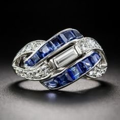 A central and sizable straight baguette diamond flashes diagonally atop interweaving rows of royal-blue calibre sapphires and sparkling diamonds in this fabulous 'right-hand ring' crafted in platinum. Although fashioned in classic Art Deco style, we think Art Deco Ring, Art Deco Jewelry, Fine Jewelry, Jewelry Design, Jewellery, Metal Jewelry, Jewelry Crafts, Silver Jewelry, Art Deco Schmuck