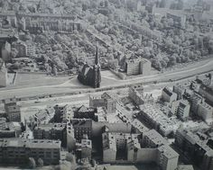 Bernauer strasse, with East Berlin in the top half of the photo, the wall in the center, and West Berlin in the bottom half. The Church of Reconciliation is in the center, just inside East Berlin, and was later demolished.