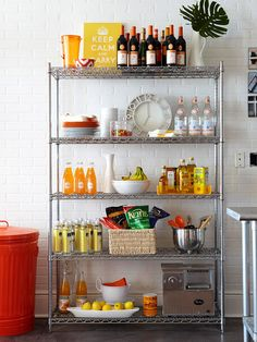 Employ an industrial metal shelving unit as extra kitchen storage if your apartment's kitchen storage options are less than generous | BHG.com