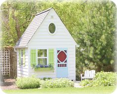 A girl can dream, right?  I would play in a playhouse like this just as much as my girls would!
