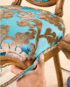 I am so reupholstering our kitchen table chairs now that I know it's so stinking easy! I can't wait!!