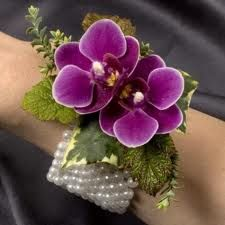 using wide band wrist with pearls fresh cut flowers orchids